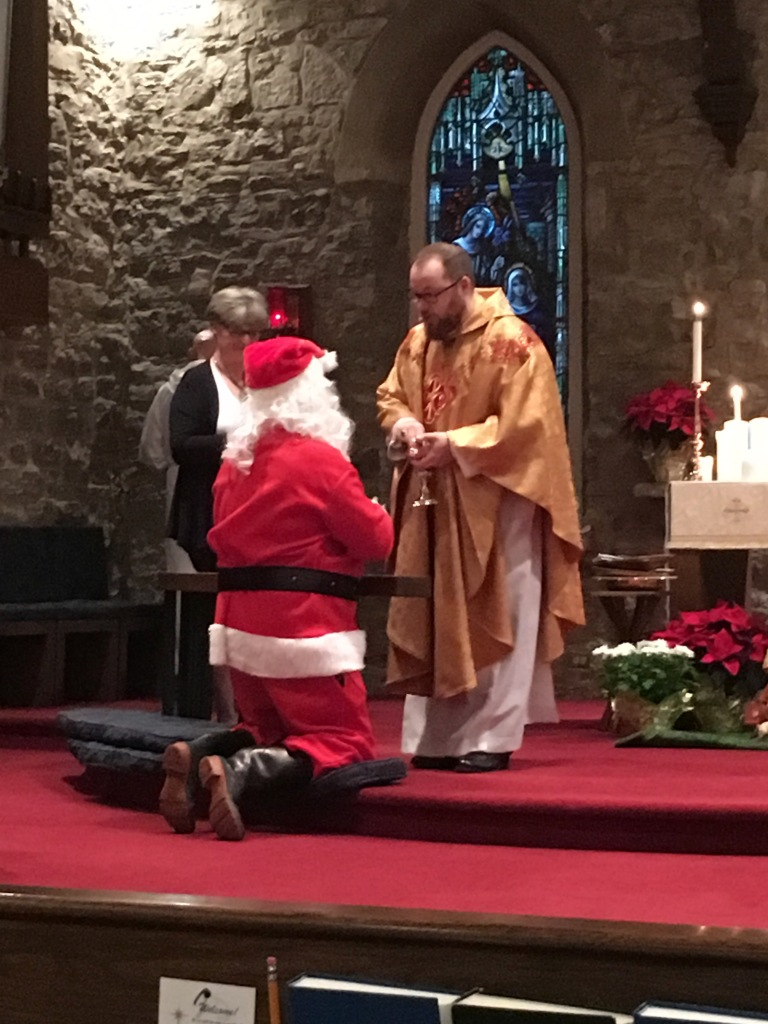 A special visitor receives the Eucharist at Christmas Eve, 2015.