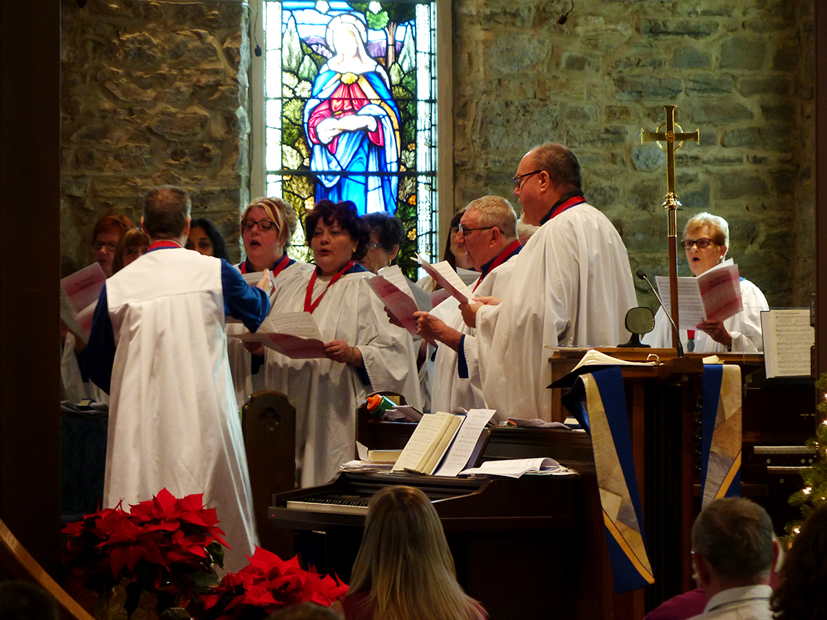 The choir sings an anthem at Lessons & Carols 2015.