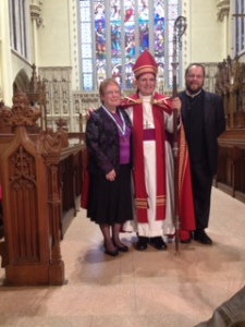 Patty with the Bishop and her rector