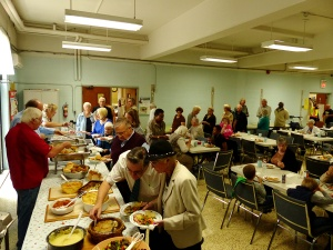 Folk gathering for Nativity's harvest lunch