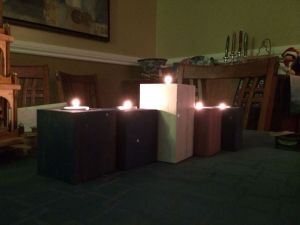 The rector's advent candles, lit all the way through for Christmas.
