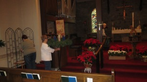 The decorating committee hard at work setting up the chancel.