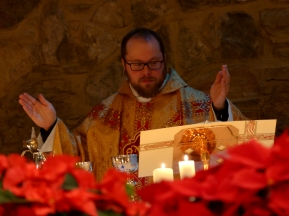 Matthew presides at the Eucharist.