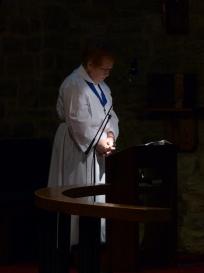 Our server prays near the altar.