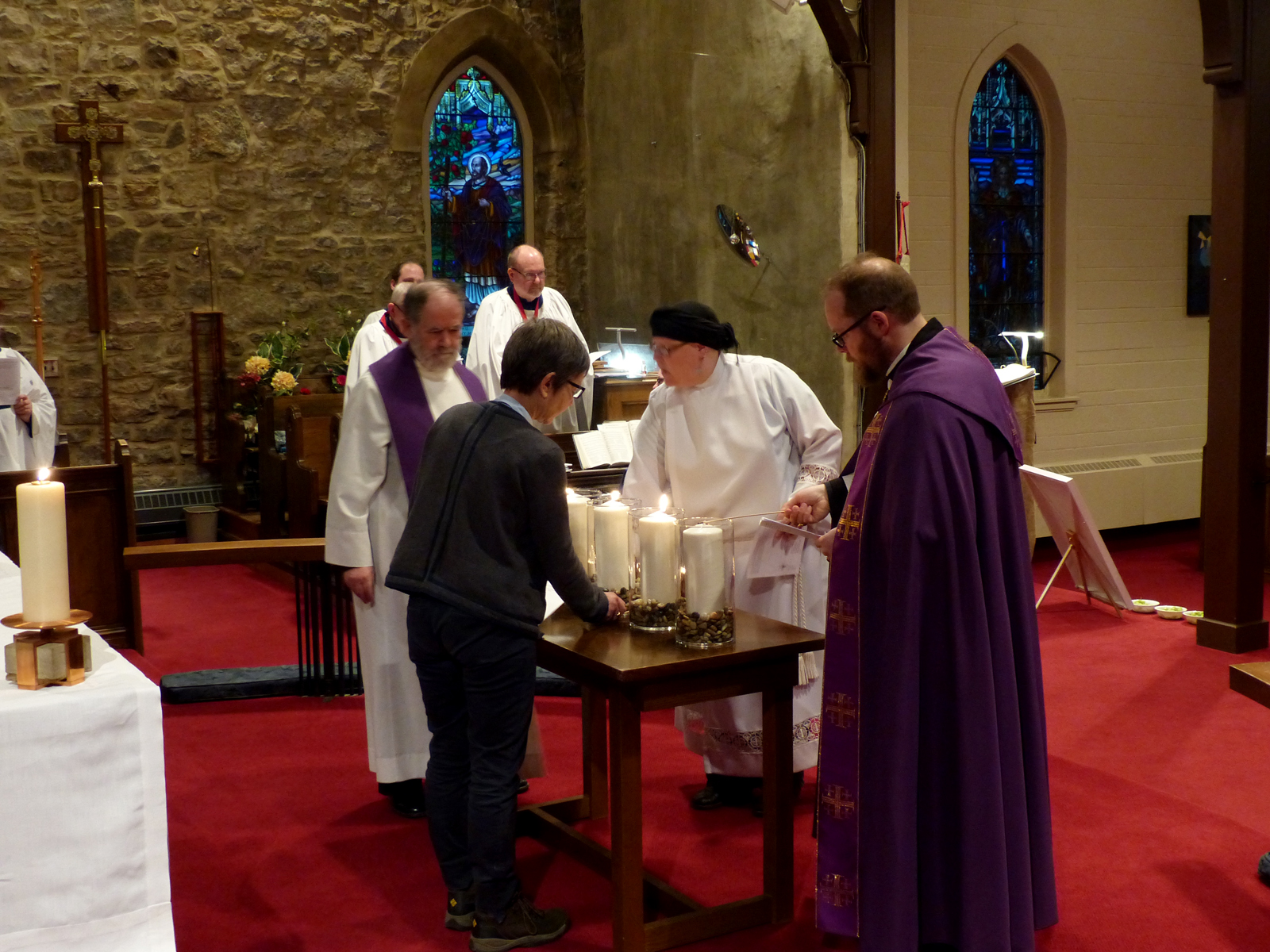 Representatives of faith communities in Hamilton light candles as part of an ecumenical service during Lent 2017.